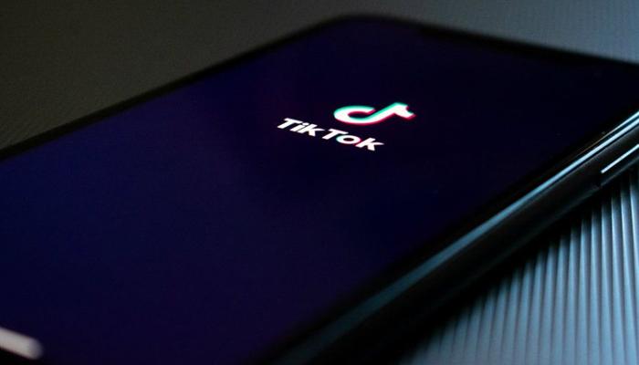 TikToks logo can be seen on a smart phone. — Unsplash/File