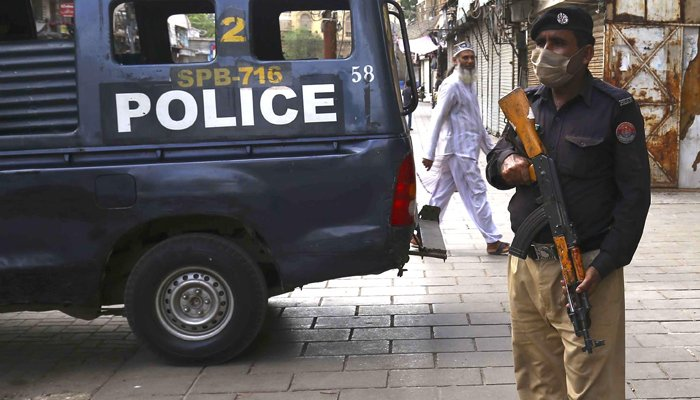 A police officer stationed at an area where a lockdown has been imposed in Karachi, on May 28, 2021. — INP/File