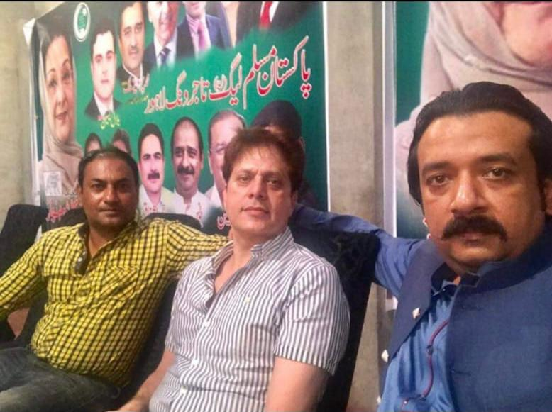 Shahid Khan (center) in an old picture taken while he attended a PML-N event in Lahore. Family sources say he later left the PML-N and joined the PTI. Photo: author