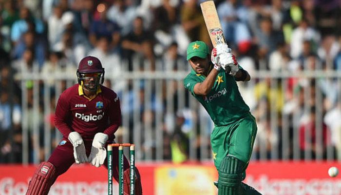 A Pakistani batsman playing a shot while West Indian wicketkeeper