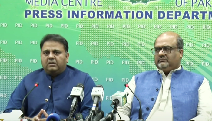 Minister for Information and Broadcasting Fawad Chaudhry (left) along withAdviser to Prime Minister on Interior and Accountability Shahzad Akbar addressing a press conference at Press Information Department in Islamabad, on July 24, 2021. — YouTube/HumNewsLive