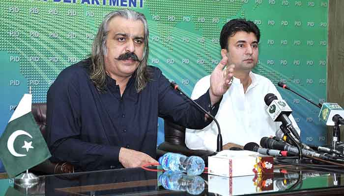 Federal Minister for Kashmir Affairs and Gilgit-Baltistan Ali Amin Khan Gandapur (L) jointly addressing a press conference with Federal Minister for Communications and Postal Services Murad Saeed, at PID Media Centre, Islamabad, on July 24, 2021. — APP photo by Saeed-ul-Mulk