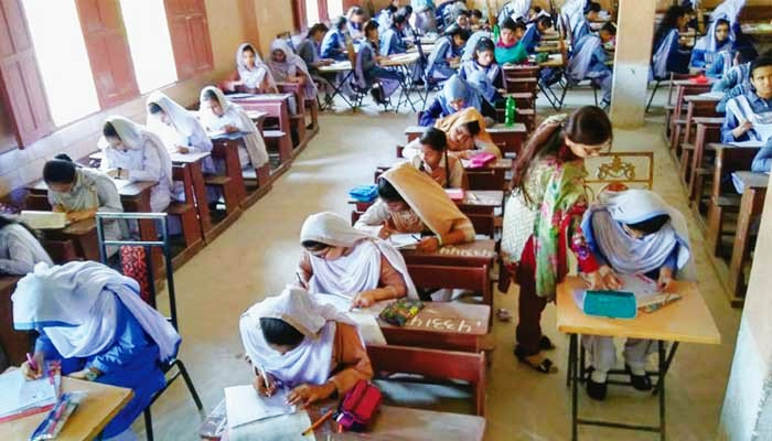 Students can be seen attempting their exams in the examination centre. — File photo