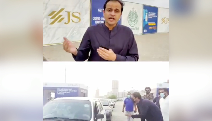 Sindh governmentspokesperson Murtaza Wahab can be seen speaking at the vaccination facility in Karachis Clifton area. — Twitter