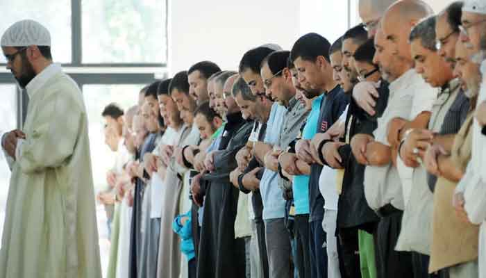 Muslims pray at the Grand Mosque of Villeneuve-dAscq, northern France, on August 01, 2011. — AFP/Philippe Huguen