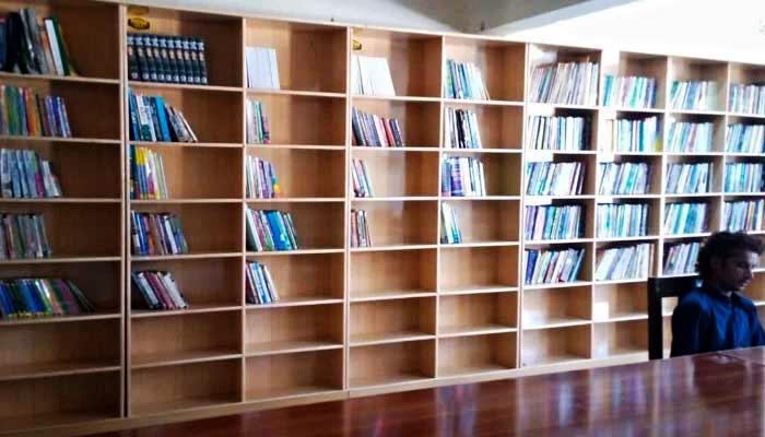The library set up by student activists in Sindhs Karoondi Town has books on a wide range of topics. — Photo by authors