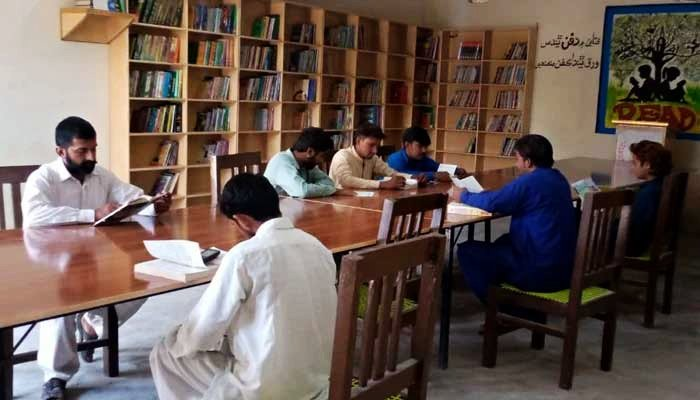 Students can be seen reading at a library established by social activists in Sindhs Karoondi Town. — Photo by authors