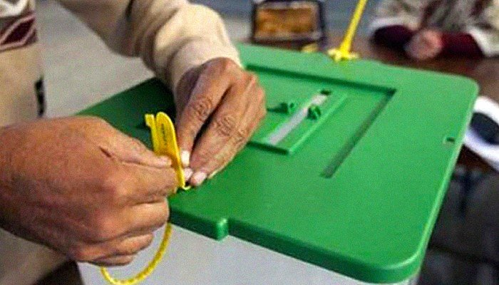 Picture showing the hands of a man touching a ballot box. Photo: File.