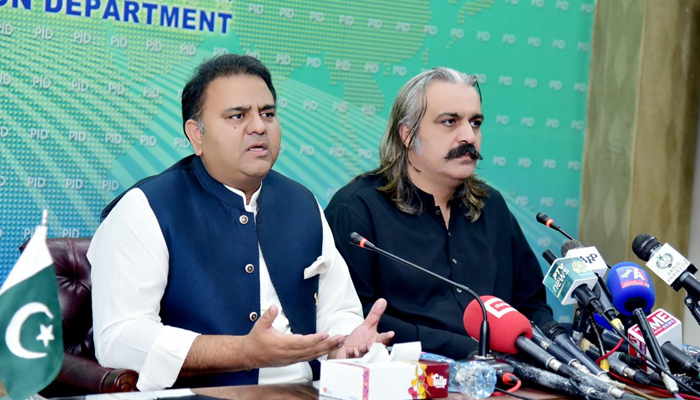 Federal Minister for Information and Broadcasting Fawad Chaudhry (left) addressing apress conference alongside Federal Minister for Kashmir Affairs and Gilgit-Baltistan Ali Amin Gandapur (right) in at PID Islamabad, on July 26, 2021. — PID