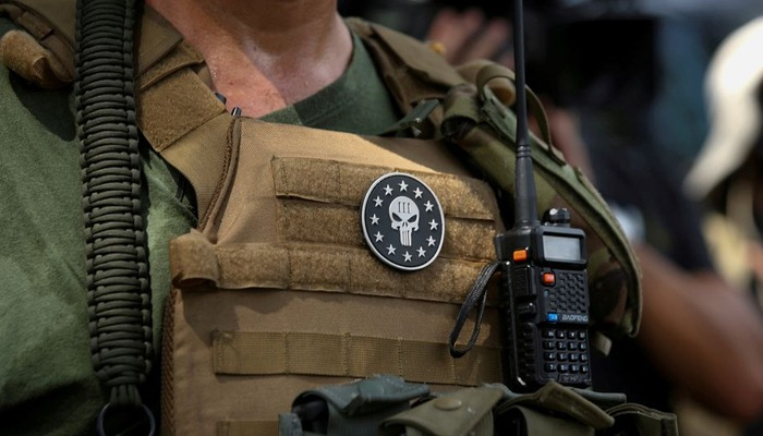A militia member with body armor and a Three Percenters militia patch stands in Stone Mountain as various militia groups stage rallies at Stone Mountain, Georgia, US August 15, 2020. — Reuters/File