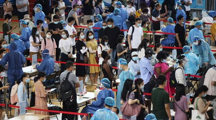 China reports highest daily rise in new coronavirus cases since January