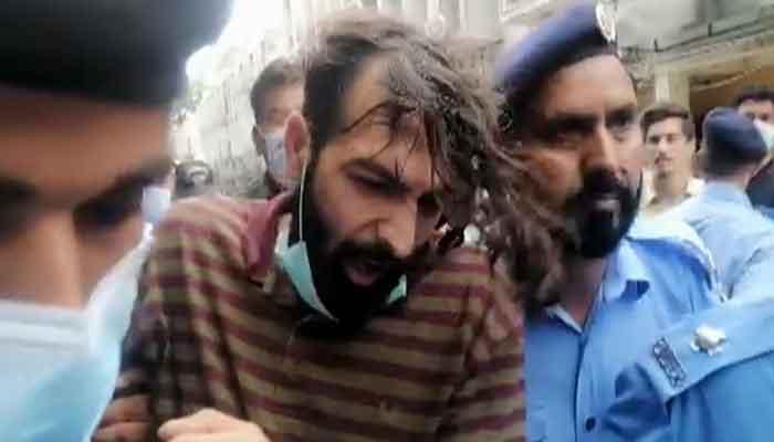 Zahir Jaffer, the alleged killer of Noor Mukadam, brought to the court in handcuffs, on July 26, 2021. — Twitter/Senator Sehar Kamran