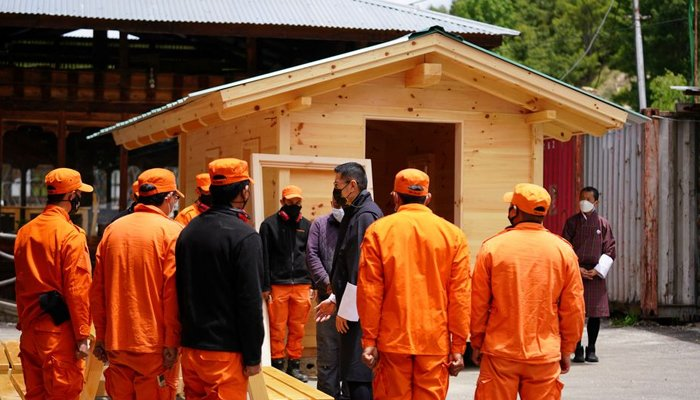 Bhutans King Jigme Khesar Namgyel Wangchuck visits a group of Desuups training at Carpentry Edelweiss during his visit to remote villages to oversee measures to contain the spread of the coronavirus disease (COVID-19) in Bumthang, Bhutan, June 7, 2021. — Reuters/File