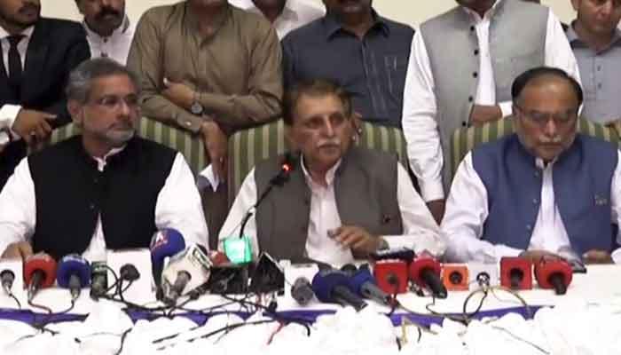 (L-R) Shahid Khaqan Abbasi, Raja Farooq Haider and Ahsan Iqbal of the PML-N, addressing a press conference, in Muzaffarabad, on July 27, 2021. — Twitter