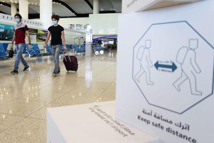 Travellers wearing protective face masks walk at Riyadh International Airport, after Saudi Arabia reopened domestic flights, following the outbreak of the coronavirus disease (COVID-19), in Riyadh, Saudi Arabia May 31, 2020. Photo: Reuters