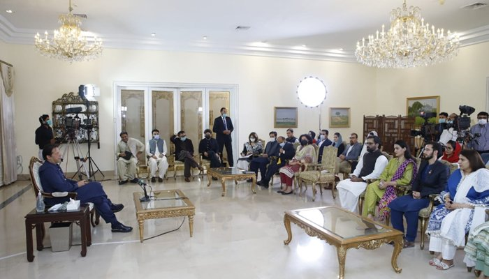 Prime Minister Imran Khan speaks with the Pak Afghan Youth Forum delegation at the PM office.  Photo: Twitter/PM Office