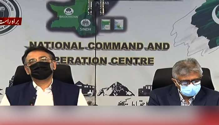 Federal ministers Asad Umar and Dr Faisal Sultan addressing media briefing at NCOC. Screengrab.