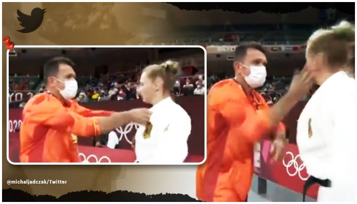Judoka Martyna Trajdos receives a couple of slaps from the coach. Screenshot from video tweeted by @michaljadczak