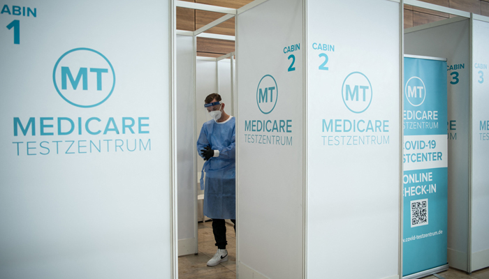 A medical staff waits for passengers to take a coronavirus (Covid-19) test at a test center at Berlin Brandenburg Airport Willy Brandt (BER) in Schoenefeld southeast of Berlin on July 28, 2021. — AFP/File