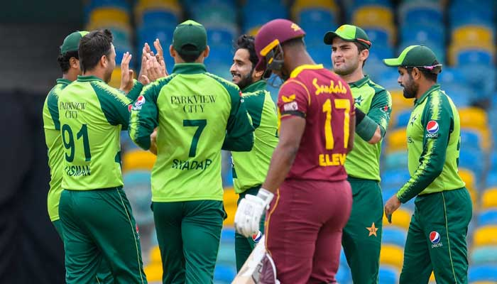 Hasan Ali (3rdL), Shareen Afridi (2ndR) and Shadab Khan (R) of Pakistan celebrate the dismissal of Evin Lewis (4thL) of West Indies during the 1st T20I between West Indies and Pakistan at Kensington Oval, Bridgetown, Barbados, on July 28, 2021.-AFP