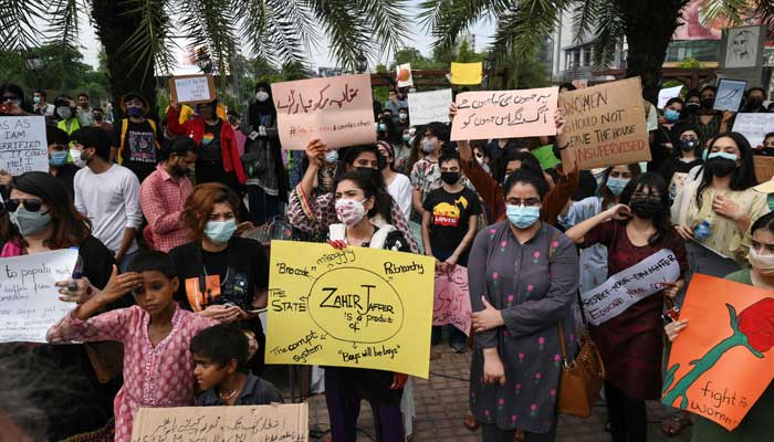 Citizens hold placards during a demonstration in Lahore on July 24, 2021, against the brutal killing of Noor Mukadam, the daughter of former Pakistan envoy to South Korea, in the federal capital earlier this week. — AFP