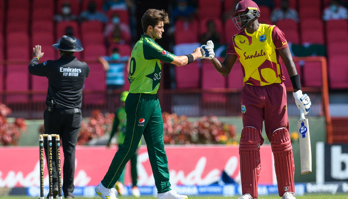 Jason Holder (R) of the West Indies congratulate Shareen Afridi (L) of Pakistan for winning the 2nd T20I match between the West Indies and Pakistan at Guyana National Stadium in Providence, Guyana, on July 31, 2021. — AFP