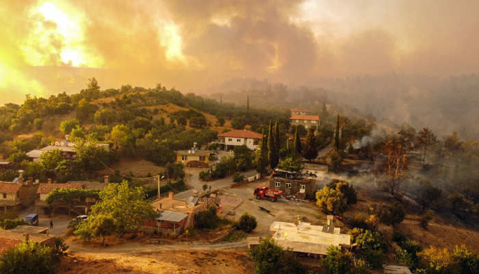 This aerial photograph shows houses surrounded by a wildfire which engulfed a Mediterranean resort region on Turkey´s southern coast near the town of Manavgat, on July 30, 2021. — AFP/File