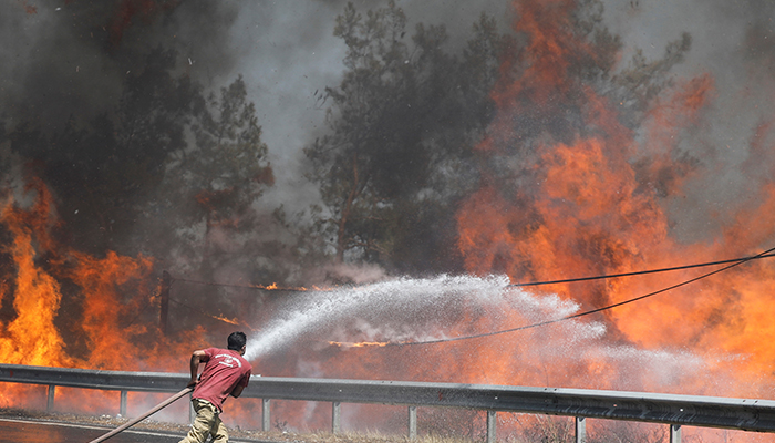 A firefighter tries to extinguish a wildfire near Marmaris, Turkey, August 1, 2021. — Reuters