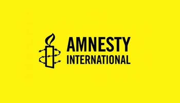 The logo of Amnesty International.