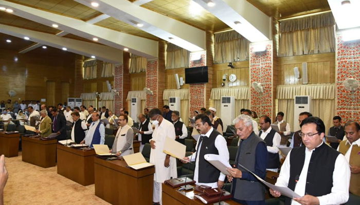 The newly-elected members of theAzad Jammu and Kashmir (AJK) Legislative Assembly under taking oath underchair of outgoing speaker Shah Ghulam Qadir in Muzaffarabad, on August 3, 2021. — Twitter/GovtofAJK