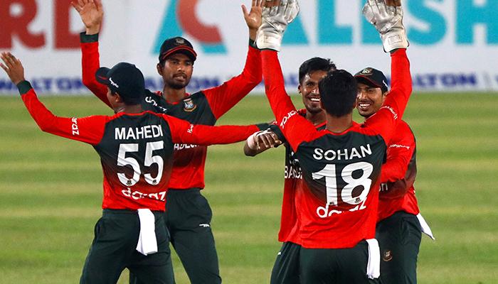 Cricket - First Twenty20 International - Bangladesh v Australia - Sher-e-Bangla National Cricket Stadium, Dhaka, Bangladesh - August 3, 2021. Bangladeshs players celebrate after winning the match. — Reuters.