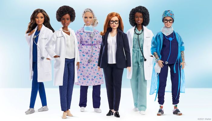 An undated handout image of a Barbie doll made in the likeness of Sarah Gilbert (3d R), the Oxford University professor who co-designed the Oxford/AstraZeneca vaccine, among a global lineup of women of healthcare sector honoured with a one-of-a-kind doll. University of Oxford/via REUTERS