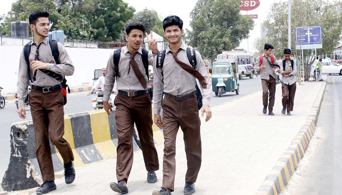 Students of a secondary educational institution can be seen outside school premises in Karachi, on June 15, 2021. — PPI/File