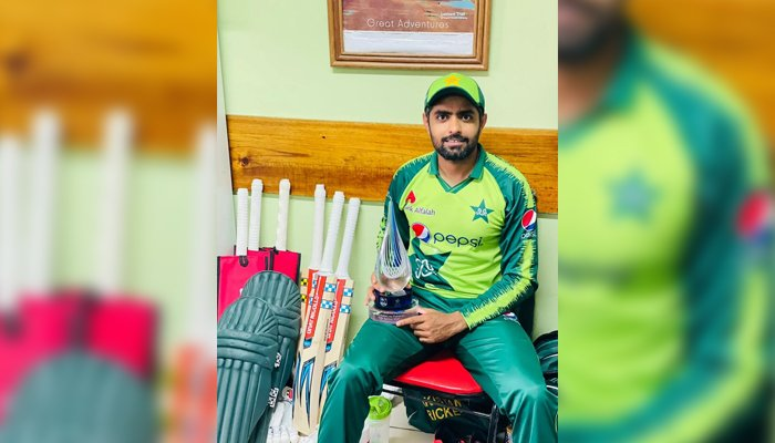 Pakistan skipper Babar Azam poses with the T20I series trophy after defeating West Indies at Guyanas Providence Stadium, on August 3, 2021. — Twitter/babarazam258