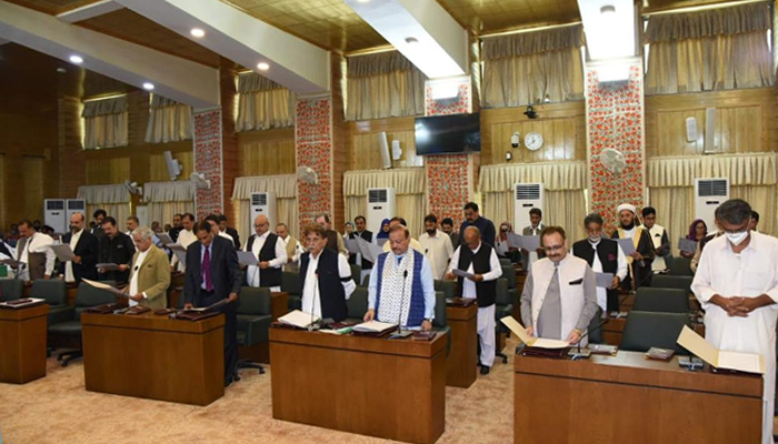 The newly-elected members of the Azad Jammu and Kashmir (AJK) Legislative Assembly under taking oath before outgoing speaker Shah Ghulam Qadir in Muzaffarabad, on August 3, 2021. — Twitter/GovtofAJK/File