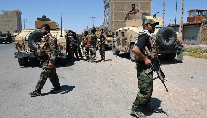 In this picture taken on August 1, 2021, Afghan National Army commando forces walk along a road amid ongoing fighting between Taliban and Afghan security forces in the Enjil district of Herat province. — AFP/File