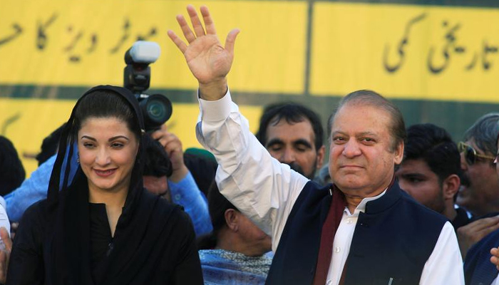 Nawaz Sharif (right), former Prime Minister and leader of PML-N, waves to supporters as his daughter Maryam Nawaz looks on during partys workers convention in Islamabad, Pakistan June 4, 2018. — Reuters/File