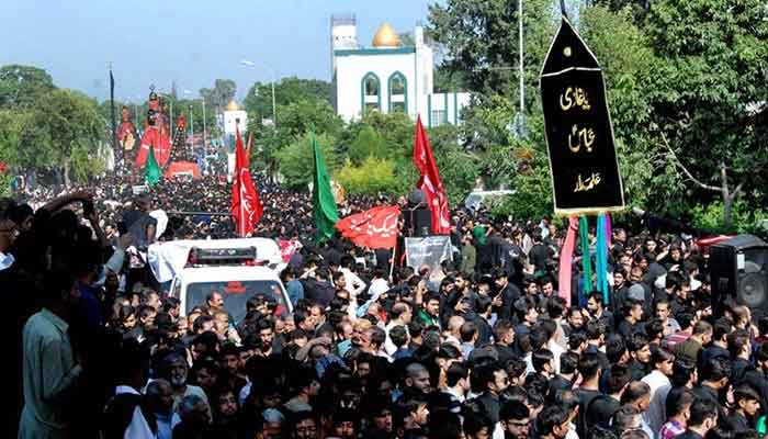A large number of mourners attending a 9th Muharram procession in Islamabad. — APP/File