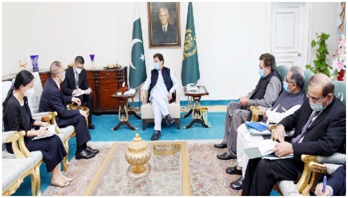 Prime Minister Imran Khan on Friday, August 13, 2021, meets with Chinas Ambassador to Pakistan Nong Rong. Photo via Radio Pakistan.