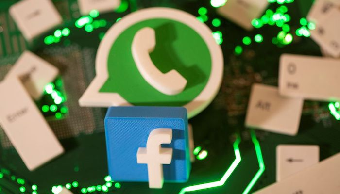 3D printed Facebook and WhatsApp logos and keyboard buttons are placed on a computer motherboard in this illustration taken January 21, 2021. Photo: Reuters