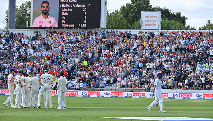 India´s captain Virat Kohli (R) walks back to the pavilion after getting out on the first day of the third cricket Test match between England and India at Headingley cricket ground in Leeds, northern England, on August 25, 2021. — AFP