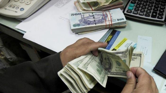 Rupee strengthens against US dollar, closes at Rs165.62