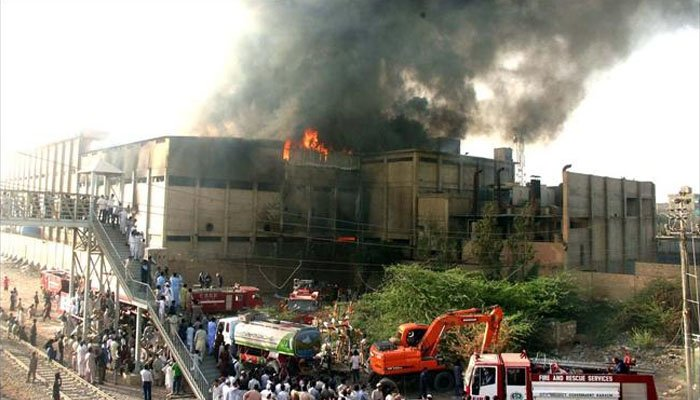 Media footage showed thick grey smoke billowing out from the top floors of the factory in Karachi. Photo: Geo.tv/ file