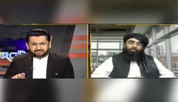 Geo News journalist Saleem Safi hosting programme Jirga (L) and Taliban spokesman Zabihullah Mujahid, during an interview, aired on August 28, 2021. — Geo News