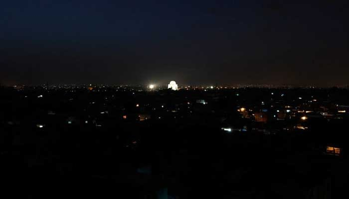 Karachi surrounded by darkness with only the Quaid;s mausoleum glowing. Photo: File