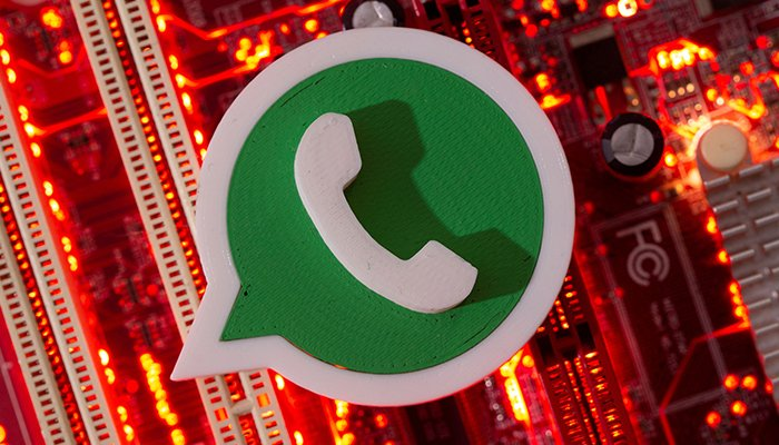 In this illustration, a 3D-printed Whatsapp logo is placed on a computer motherboard taken on January 21, 2021. — Reuters/File