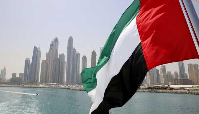 UAE flag flies over a boat at Dubai Marina, Dubai, United Arab Emirates May 22, 2015. — Reuters/Ahmed Jadallah