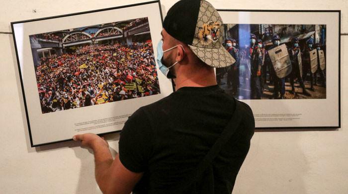 Anonymous Myanmar photographer wins major photojournalism award
