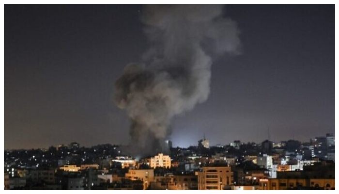 Smoke billows from a building in Gaza bombarded by Israeli jets. Photo: AFP