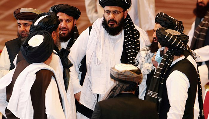 Taliban delegates speak during talks between the Afghan government and Taliban in Doha, Qatar September 12, 2020. — Reuters/File